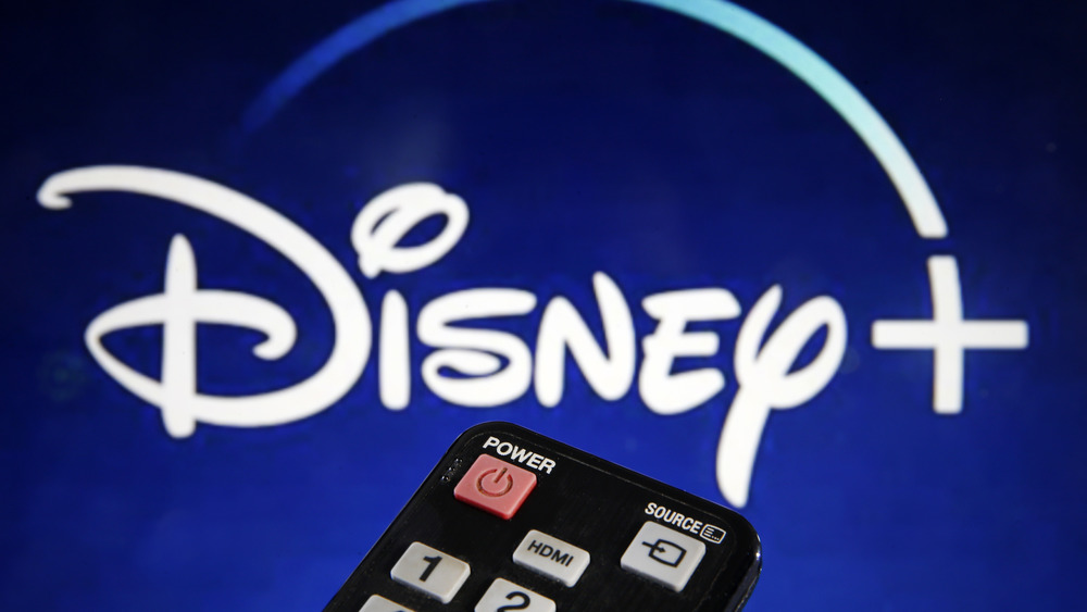 The Disney+ logo with a remote control