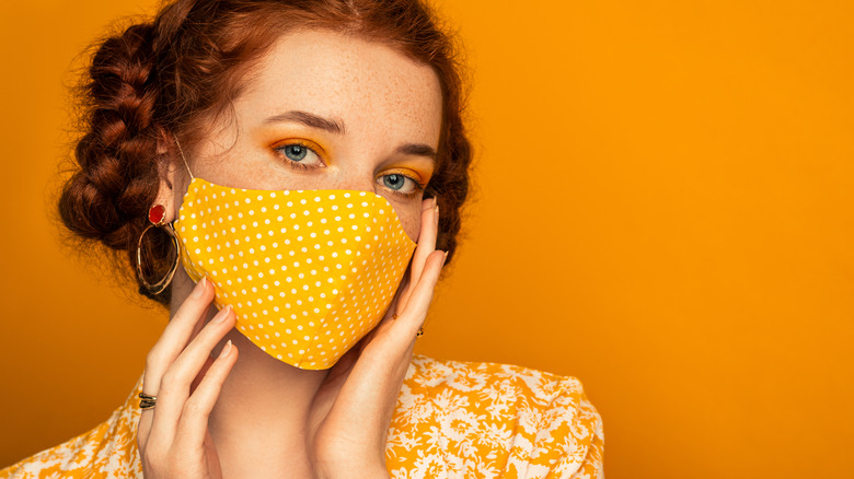 Trendy woman posing with mask