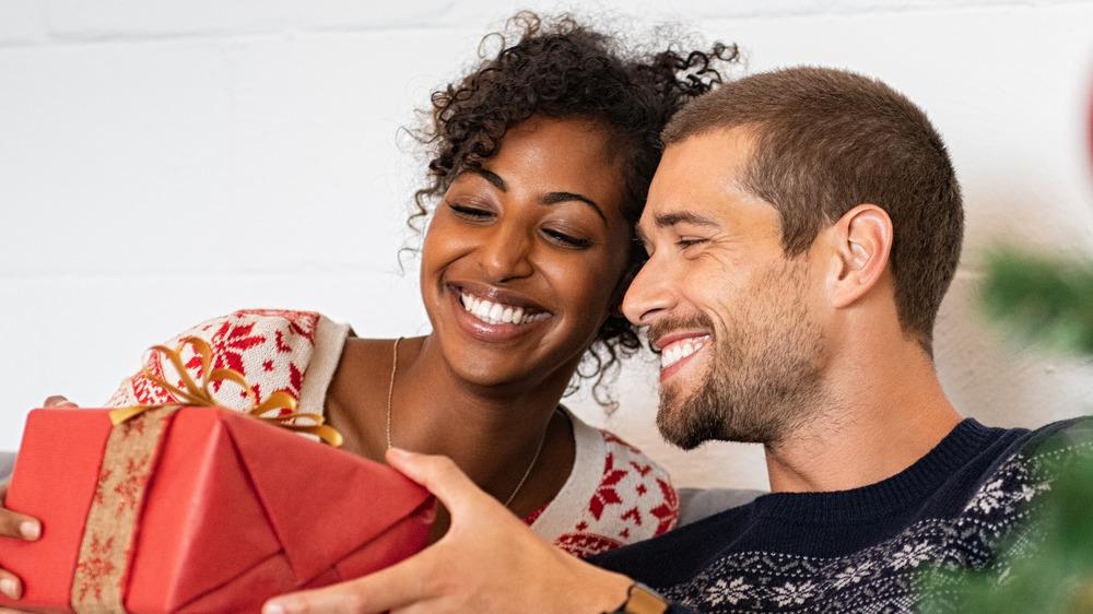 man giving woman holiday gift