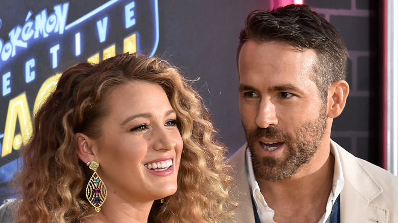 Ryan Reynolds and Blake Lively stand together on red carpet