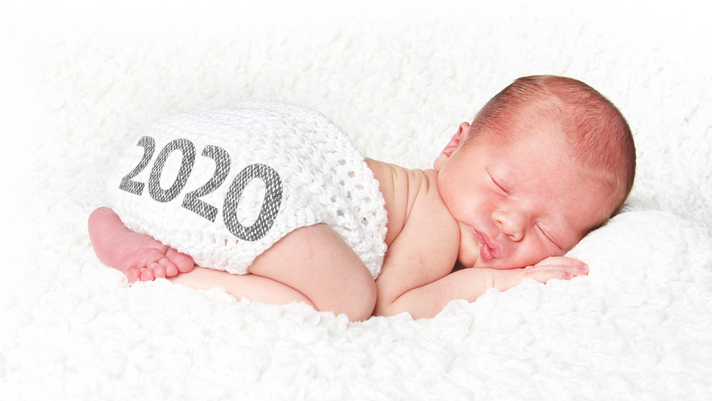Baby with 2020 on diaper