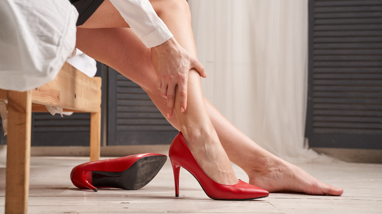 Woman experiencing pain from stilettos