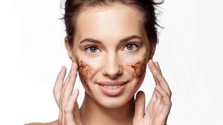 woman applying homemade facial scrub