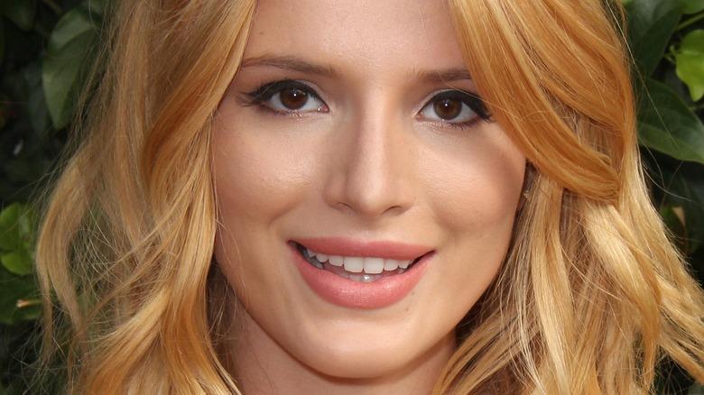 Bella Thorne smiles