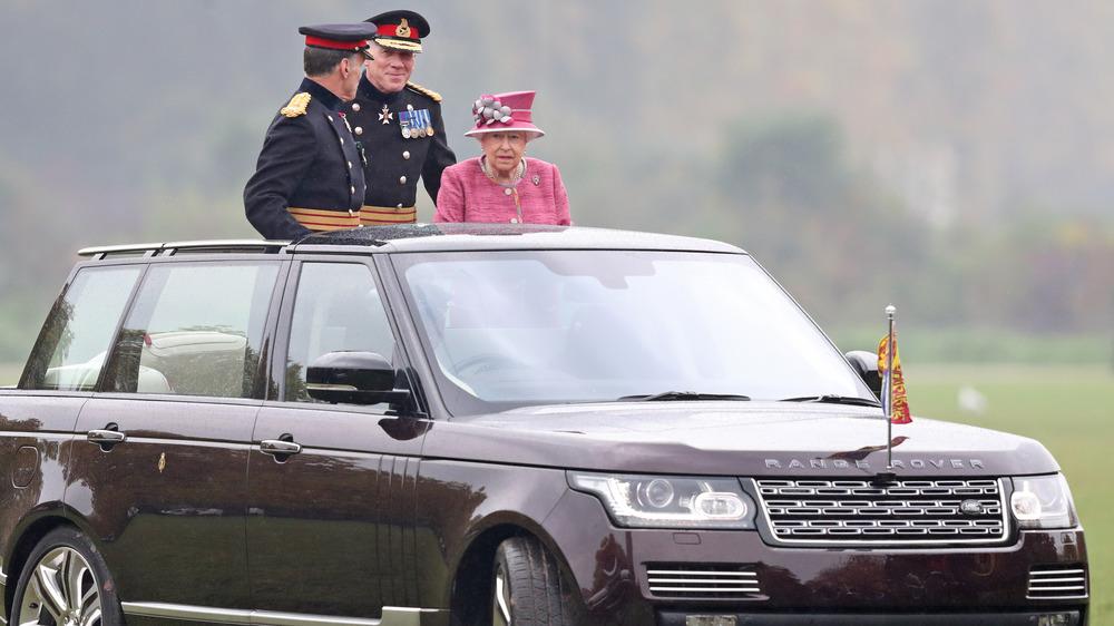 Queen Elizabeth riding In car