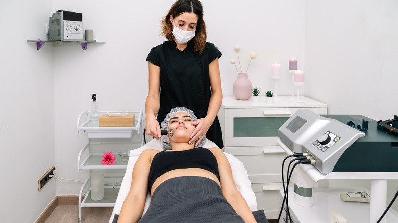Aesthetician giving woman a treatment