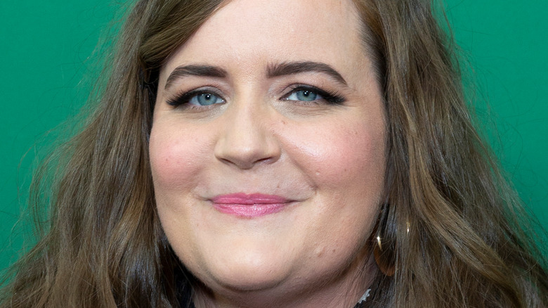 Aidy Bryant poses with a smile