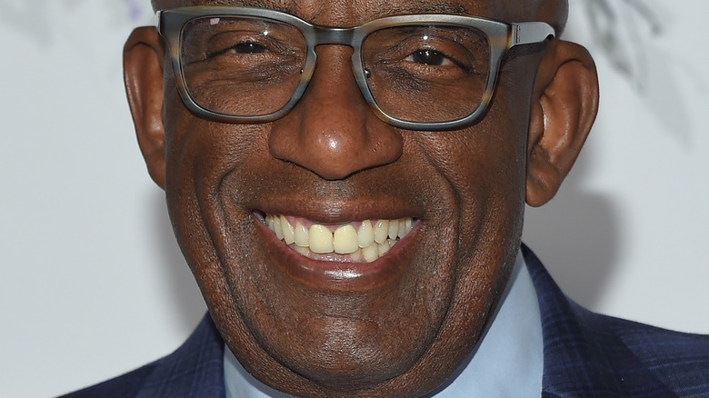 Al Roker wearing glasses and smiling