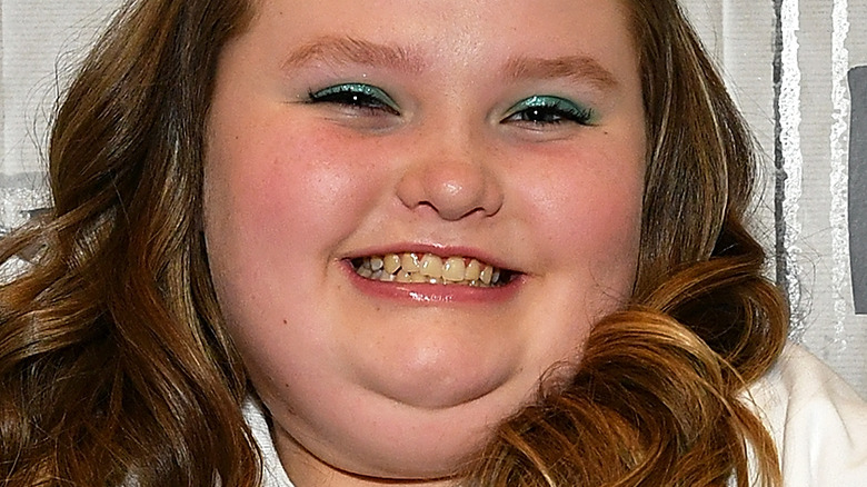 Alana Thompson smiles on the red carpet