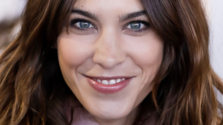 Alexa Chung with wide smile and hair down