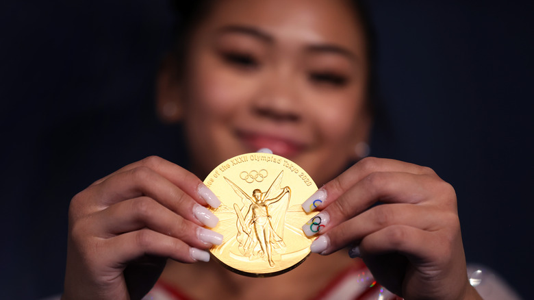 Suni Lee shows off gold metal and Olympic printed nails