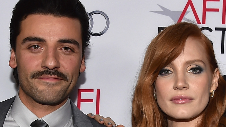 Jessica Chastain and Oscar Isaac pose for a picture at a movie premiere