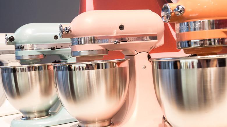 Three KitchenAid stand mixers lined up