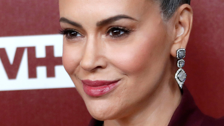 close up of Alyssa Milano with her hair up