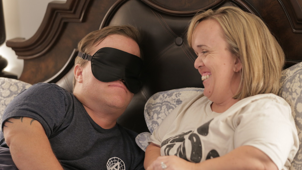 Trent Johnston in a sleep mask with Amber Johnston