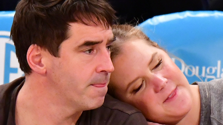 Amy Schumer and husband Chris Fischer snuggling
