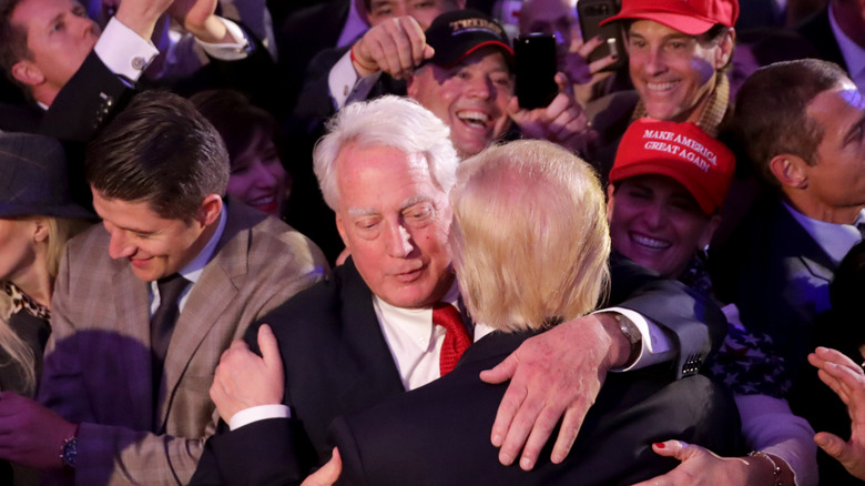 Robert and Donald Trump hugging