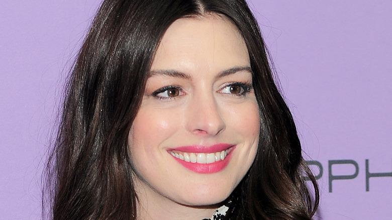 Anne Hathaway purple background