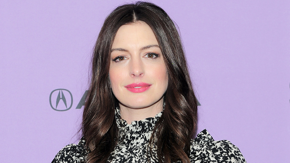 Anne Hathaway smiles at event