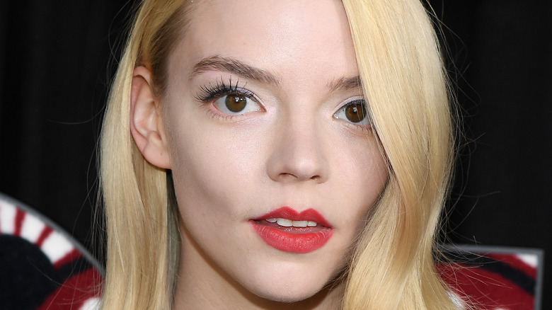 Anya Taylor-Joy grinning with red lip