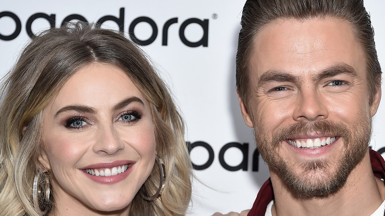 Julianne Hough and Derek Hough posing at event