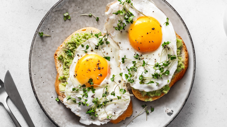 Eggs with soft yolks on toast