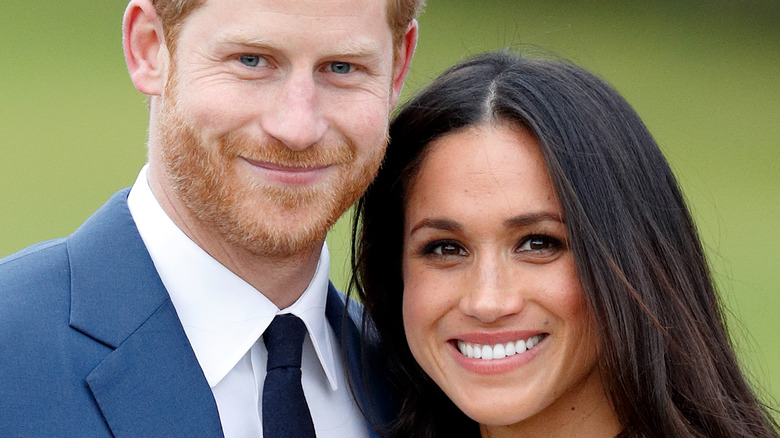 Prince Harry and Meghan Markle pose for the camera.