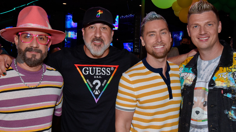AJ McLean, Nick Carter, Lance Bass, and Joey Fatone at a performance.