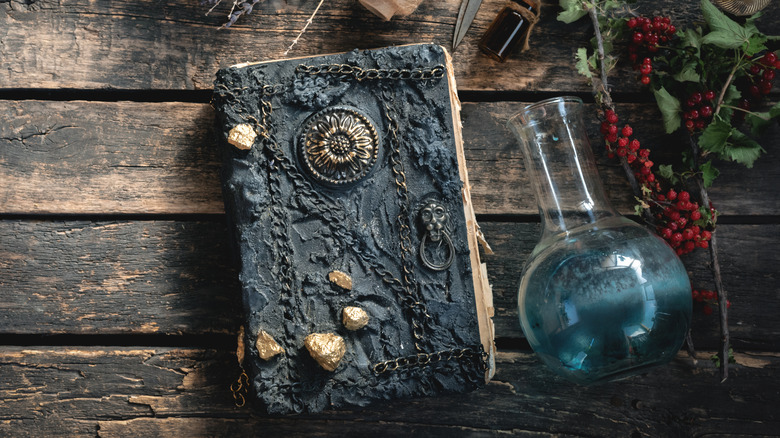 Book and potion on table