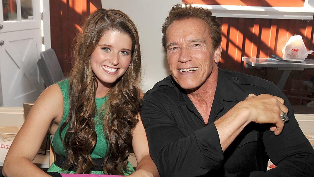 Katherine Schwarzenegger and Arnold Schwarzenegger posing