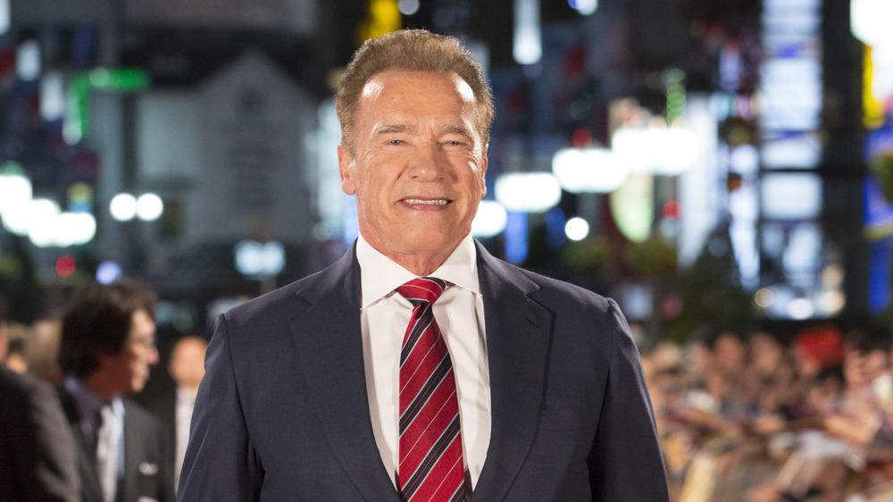 Arnold Schwarzenegger in a red tie