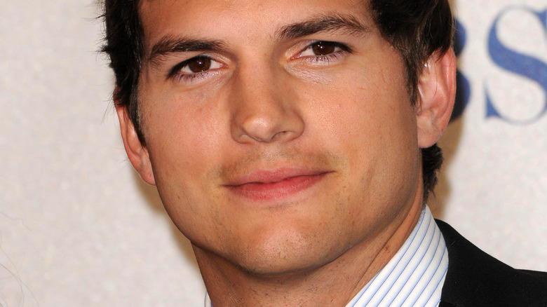 Ashton Kutcher looking into camera