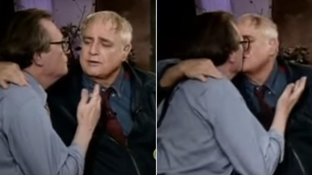 Marlon Brando kissing Larry King