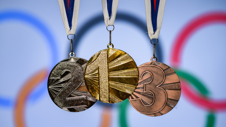 Olympic rings and gold, silver, bronze medals