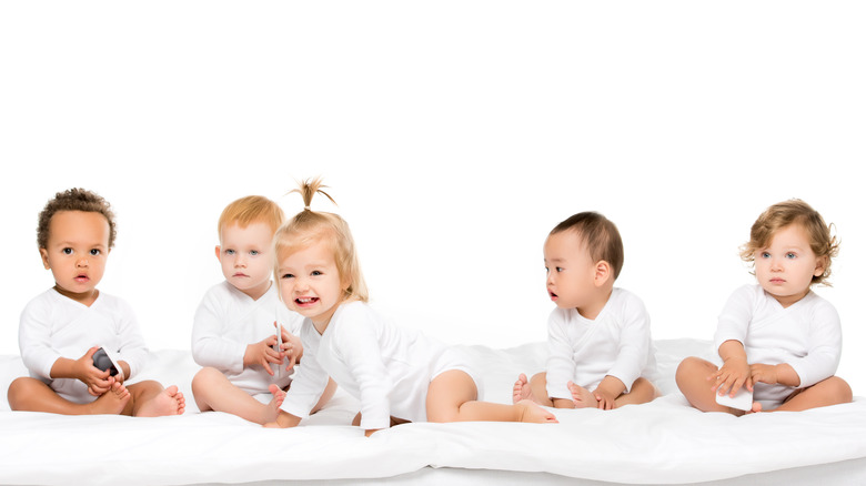 Group of babies of various genders and ethnicities