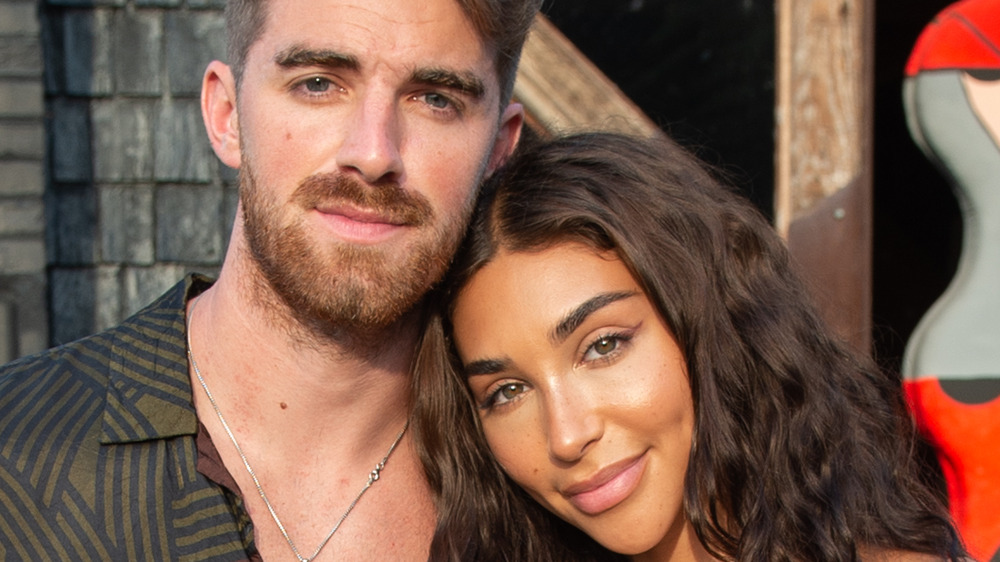 Chantel Jeffries and Drew Taggart snuggle up at an event
