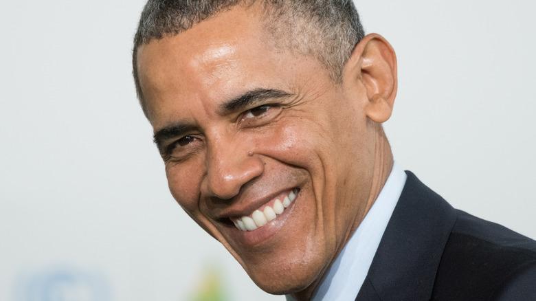 Barack Obama smiling head tilted
