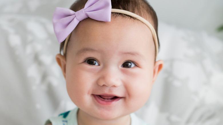 Baby with bow headband