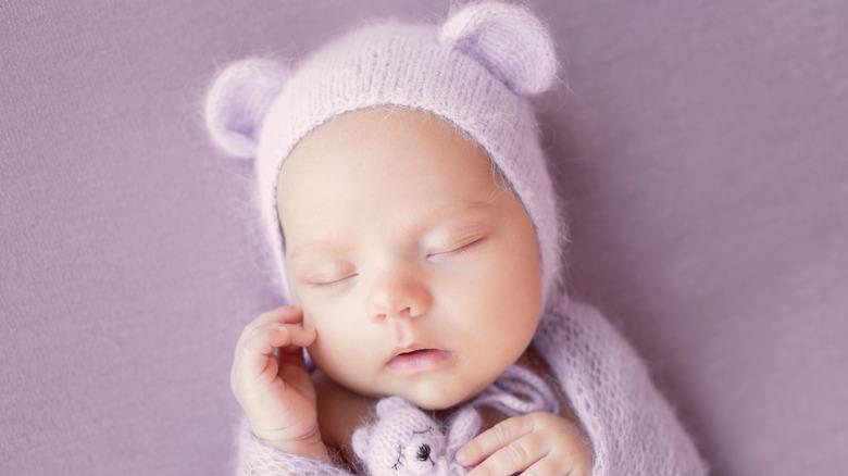 Baby in purple