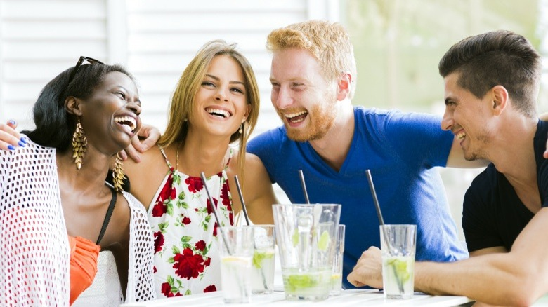 friends laughing double date attraction