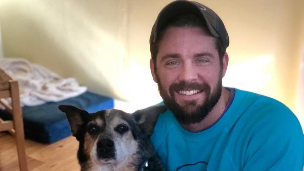 Below Deck's Eddie poses with his dog