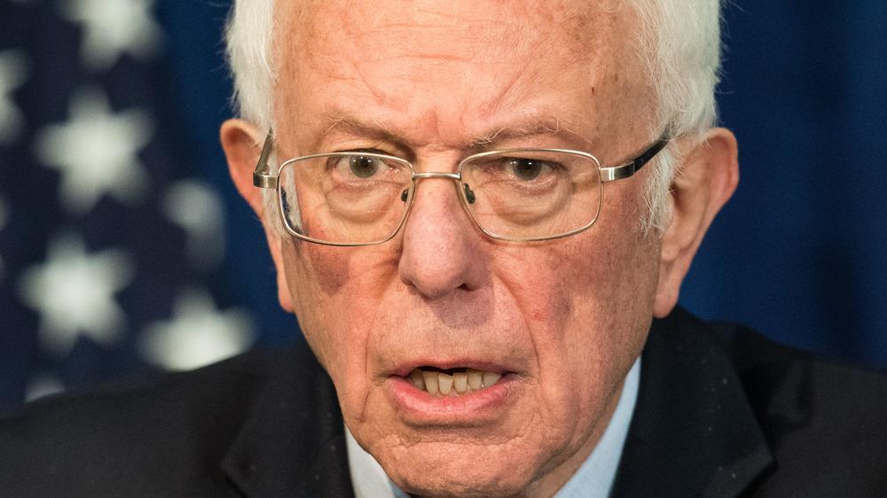 Bernie Sanders giving a speech in glasses