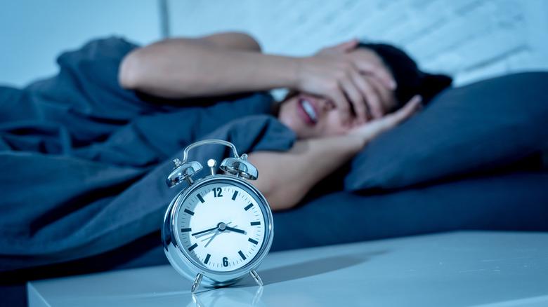 woman who can't sleep with alarm clock