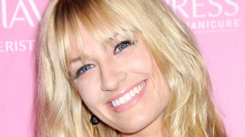 beth behrs smiles