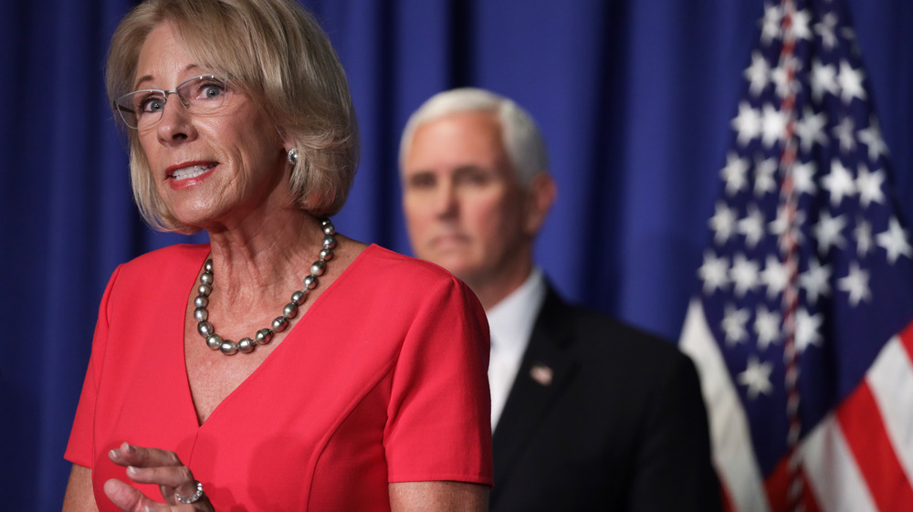 Betsy DeVos and Mike Pence