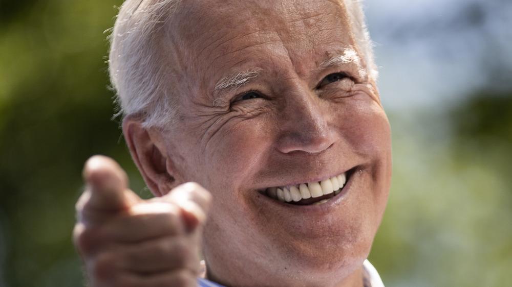 President Joe Biden looks elated onstage