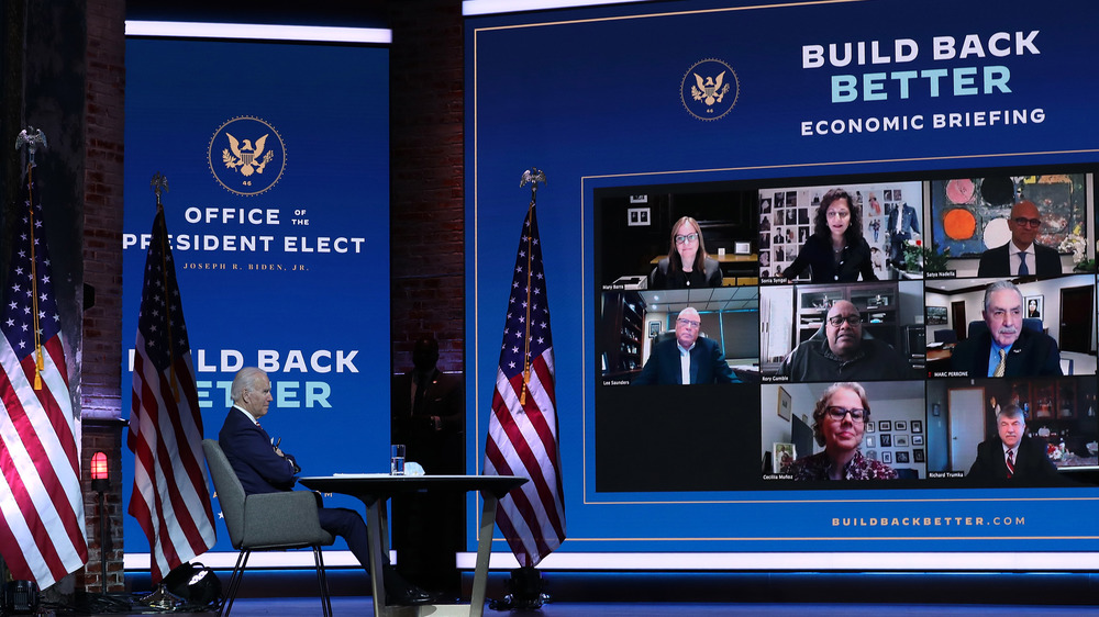 Biden speaking to advisers on a video wall
