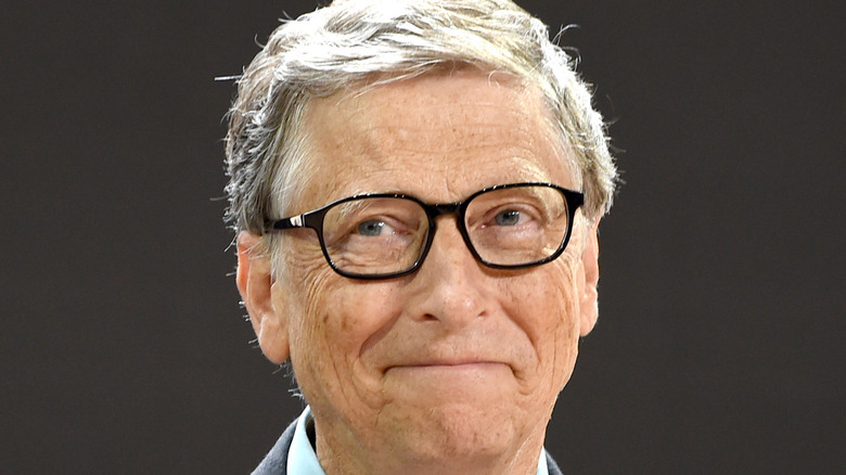 Bill Gates smiles at an event