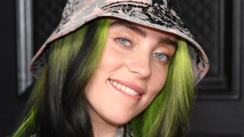 Billie Eilish poses on the Grammy red carpet