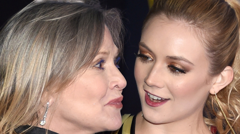 Carrie Fisher and Billie Lourd smiling at each other
